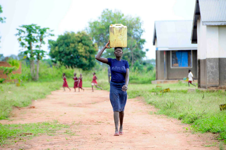 Drop in the Bucket Africa water charity-Uganda Girl walking for water Gender Equality