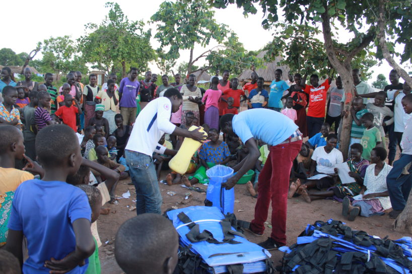 Drop in the Bucket field staff distributing Pack H2O water backpacks at the Palabek Refugee Settlement in Uganda.