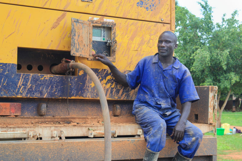Drop in the Bucket driller sits on a Compair screw tack compressor in Uganda highlighting importance of World Water Week