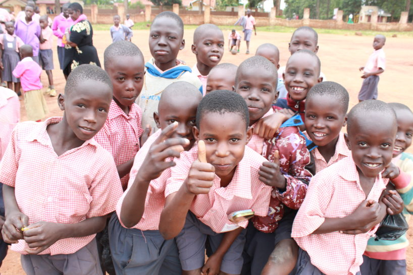 Happy kids by a water well drilled by Drop in the Bucket in Uganda