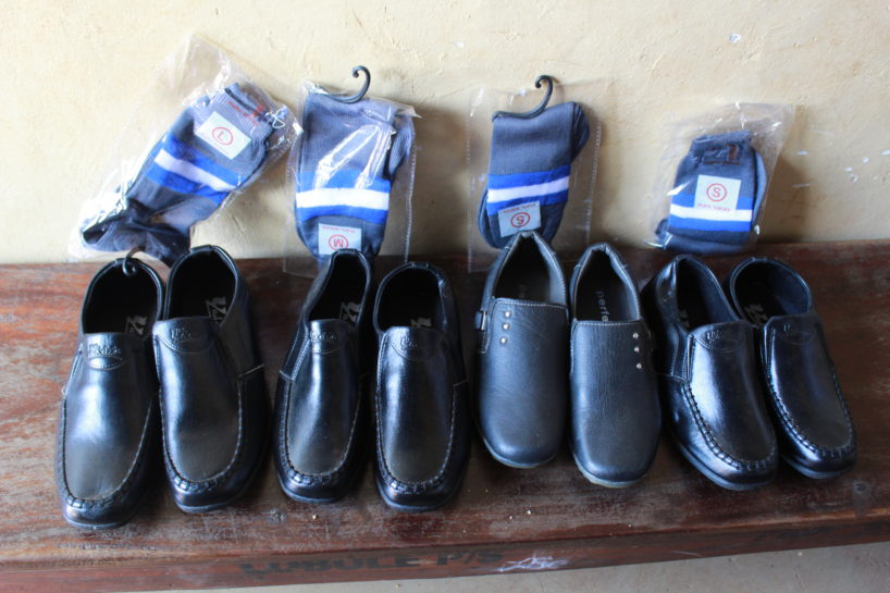 Four pairs of black shoes for students in Uganda from Drop in the Bucket