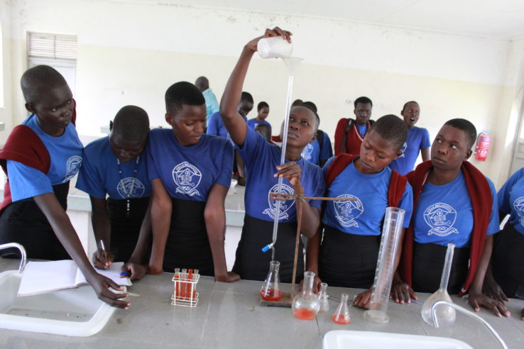 Young female students learn about science in chemistry in a school in Uganda
