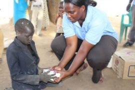 Drop in the Bucket staffcdistributing soap to refugees in South Sudan